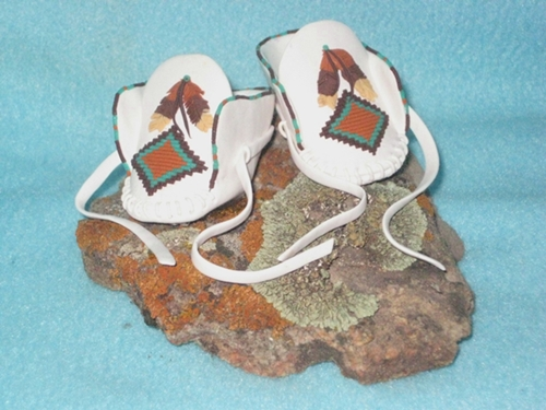 white feather moccasins